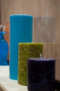 Blue_Green_Purple_Candles_on_White_Shelf_beige_Background_IMG_0532_LR_bci